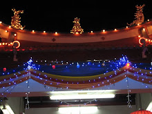 Temple rooftop lighted up for Wesak