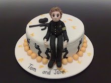 "Tom and John's Paintball Cake at Delta Force              ""Click on Photograph"""