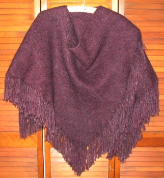 A 2 triangle ruana, also tri-loom woven.