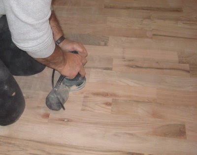 Hand sanding with an orbital sander