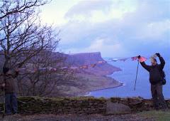 Flags overlooking Murlough Bay and Fair Head