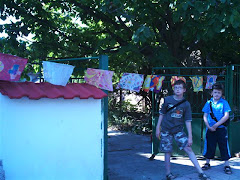 Two boys at a house in Bulgaria with flags