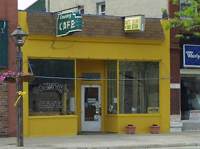 new yellow paint on Country Cafe and Dar's Hair Salon in Madison  SD