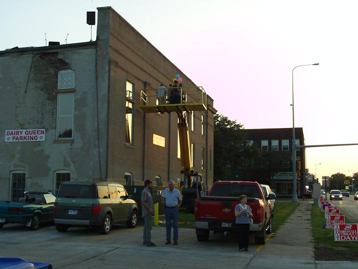 Taking the band upstairs: Madison's Only Band rides the telehandler to the Masonic Temple roof for an evening concert, August 5, 2010.