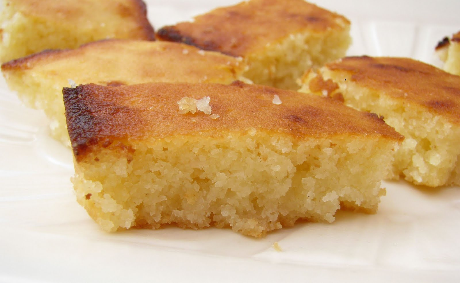 basbousa is a sweet cake made with semolina and soaked with syrup ...