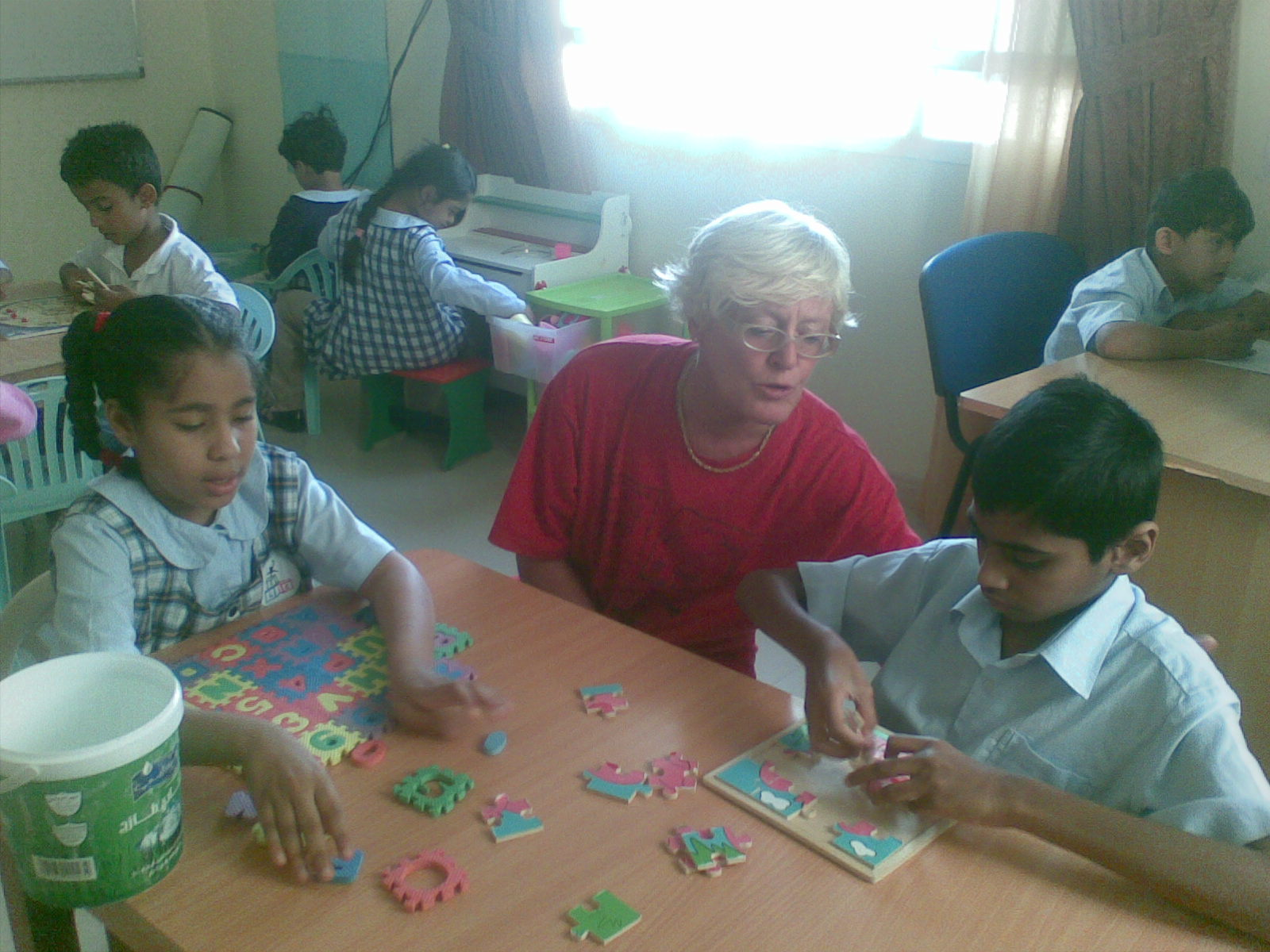 The children have arts and crafts, computer, English and Arabic, ...