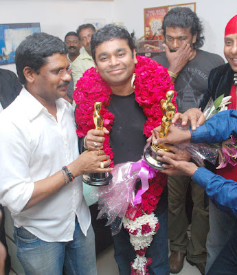 A R Rahman returned by an emirites filight to a rousing welcome at the Anna International Air Terminal after winning two oscars