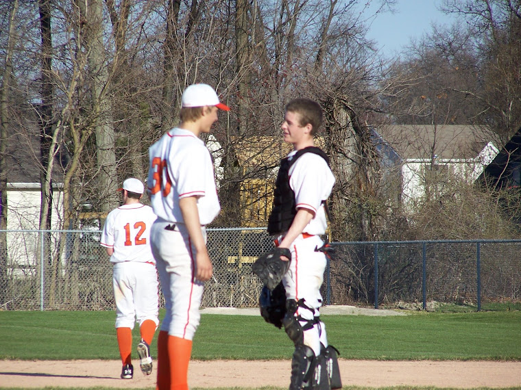 Adam Klepzig and Tyler Falor talk things over...