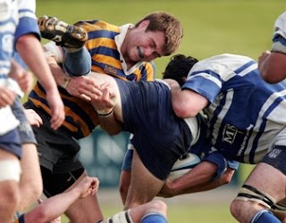 Sydney University forward Ben McCalman finishing a tackle