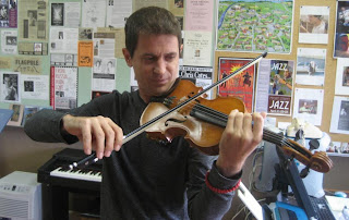 Violin professor takes center stage