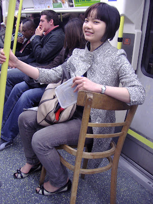 sitting on seatless chair