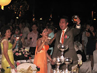 The wedding couple having a toast with his guest at the beach wedding