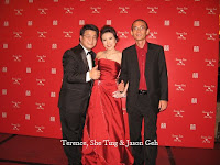 An image of the newly weds Terence and She Ting with live band manager Jason Geh