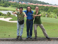The three band members posing