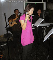 singer Nas Adila singing with the live band