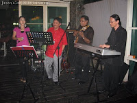 Birthday boy jamming with singer and band