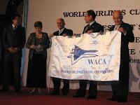 airline delegates holding waca's flag