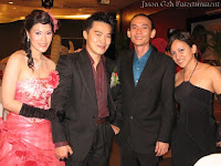 Bridal couple posing with Jason Geh and singer