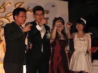The wedding couple having a toast with their guest