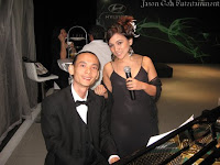 Singer and Pianist by the grand piano
