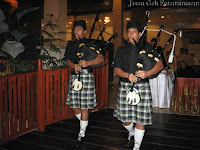Live Bagpipe players integrating with the food presentation
