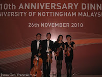 Jason Geh String Quartet posing by the backdrop