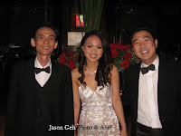 Band manager, band leader and keyboardist Jason Geh flanked by wedding couple Fiona and Abel