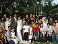Wedding couple with their family and friends