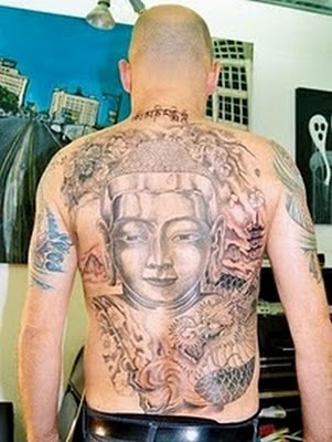 Buddhist tattoo of the Buddha sitting on a lotus flower. Big Buddha Tattoo Design