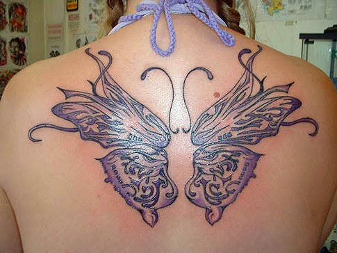 Butterfly Tattoos on Upper Back for Girl | Tribal Tattoo Idea