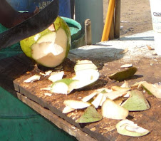 Chopping coconuts for Coco Frio in Piñones