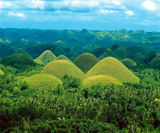 Bohol's Chocolate Hills turn Green