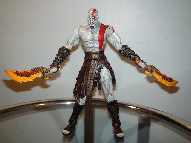 Pseudo figures kratos with flaming blades of athena god of war