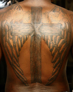 cross back piece tattoo