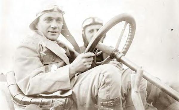 L. Strang in his race car, 10-21-1908