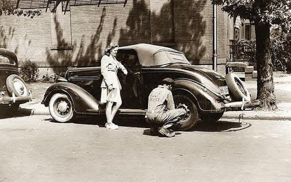 Changing tire for girl, Washington DC, 1942