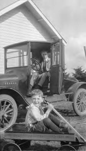 Boy with Sherwood Spring coaster wagon 1920