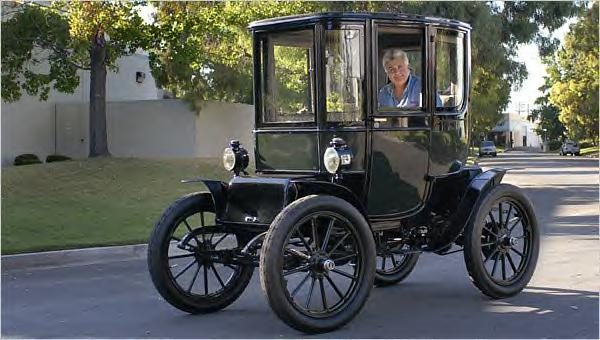 Jay Leno is known for his massive classic car collection. Here he is in his 1909 Baker Electric ~