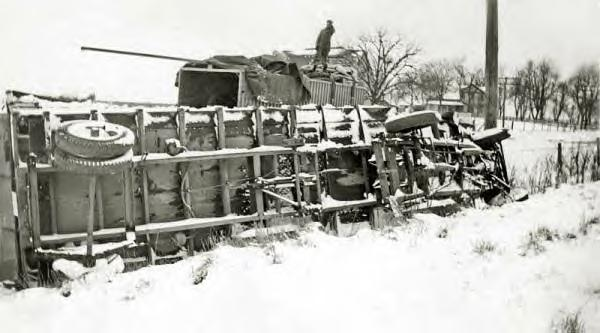 Akron Motor Cargo Co. Wreck. Earl Sowers standing on top of a trailer. 4-1-1936