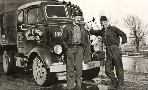 Jim Ennis and an unidentified man standing in front of an Akron Motor Cargo truck. Late 1930s