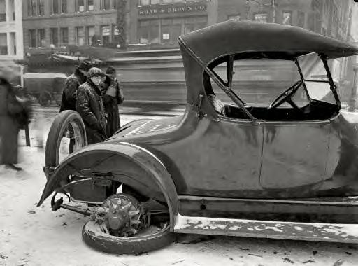 Washington, D.C., 1917. Dr. W.J. Davis with a flat tire in winter