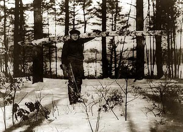 Babe Ruth carrying a log. Undated