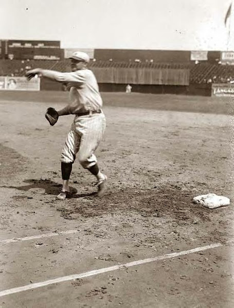 Babe Ruth pitching on field