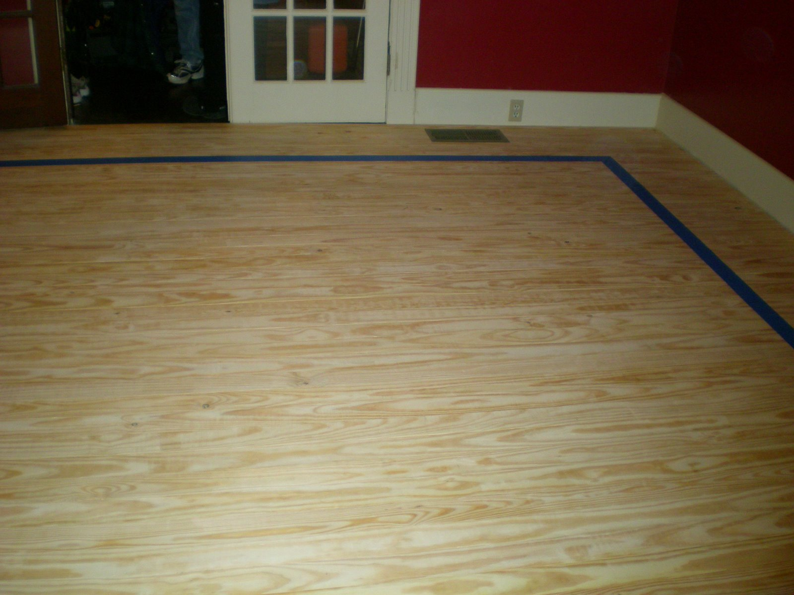 Stained plywood flooring