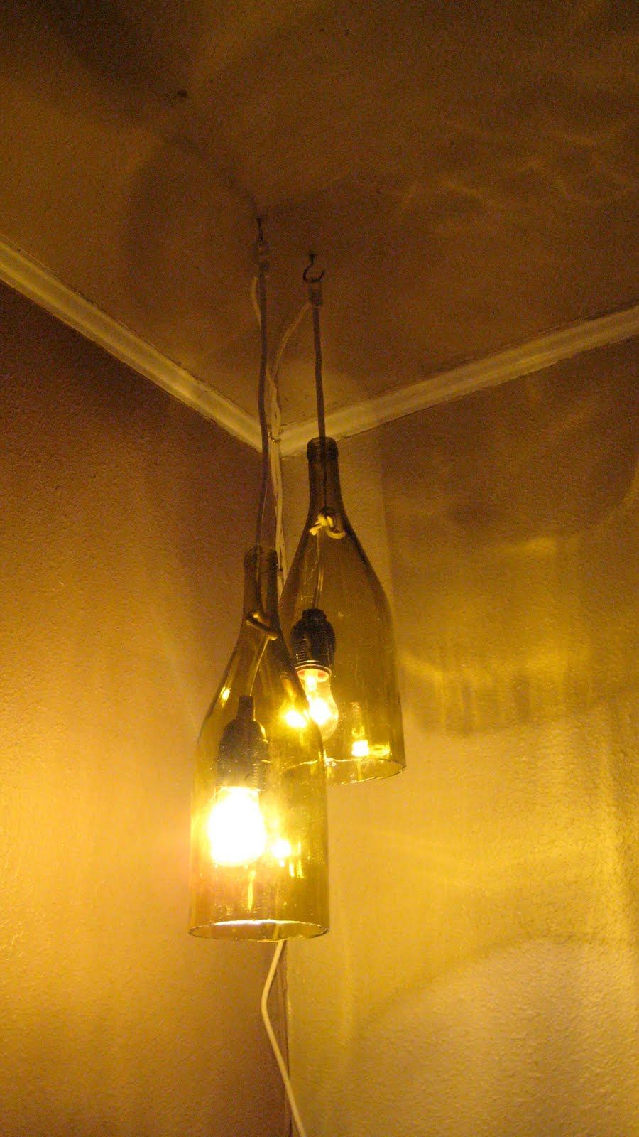 Remodelaholic how to make a glass wine bottle pendant for Diy pendant light
