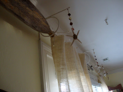 oars as curtain rods with burlap curtains