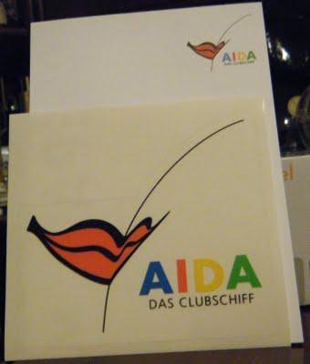 """Autocolante e bloco de notas """"AIDA"""""""