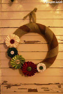 http://www.aglimpseinsideblog.com/2010/12/ribbon-medallion-burlap-wreath-tutorial.html