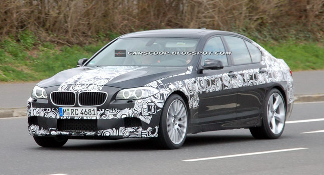 2011 BMW M5 001 SPIED 2011 BMW M5 Super Saloon Sheds More Camouflage Photos