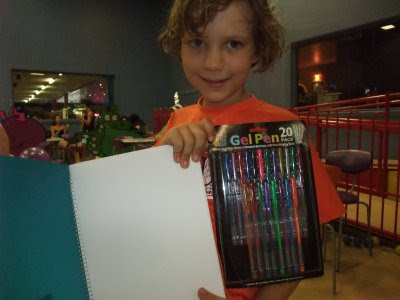 The Birthday Boy with drawing pad and pens